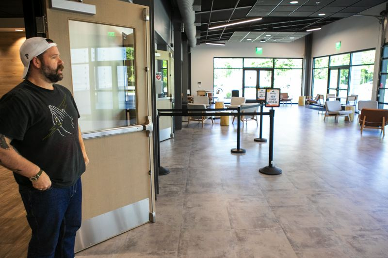 PMG PHOTO: JAIME VALDEZ - Jake Schwein, Grace Chapel's campus pastor & pastor of worship and justice, stands in the lobby  area where a coffee shop will be open daily to the public.