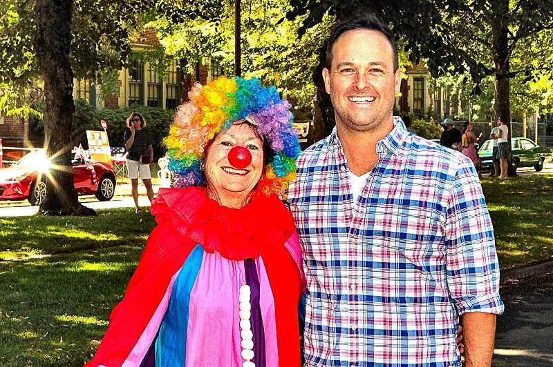 DAVID F. ASHTON - The Official Eastmoreland Independence Day Parade Clown - for the 4th year - was Sharon Richardson - here, spending a moment with this years organizer, Andrew Centibear.