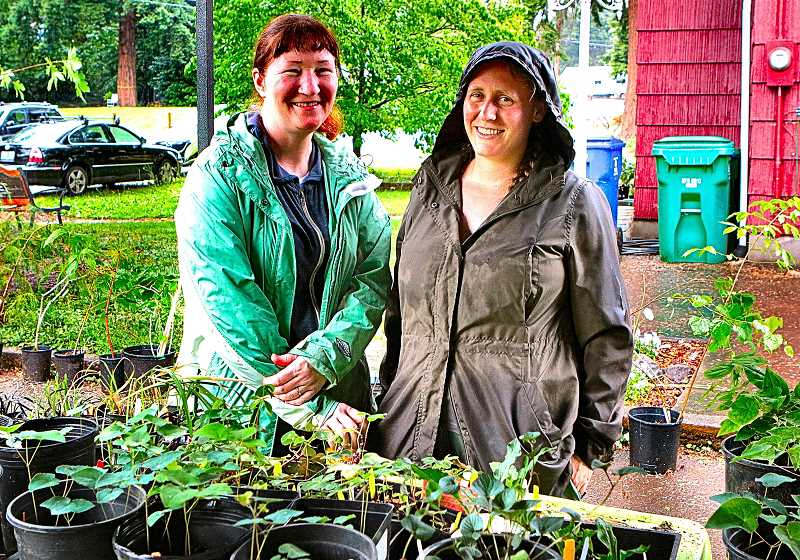 DAVID F. ASHTON - Volunteers helping out at this years Balfour Park Plant Sale included Ardenwald-Johnson Creek Neighborhood Association Land Use Chair Lisa Gunion-Rinker, left, and Board Member Chris Holle-Bailey.