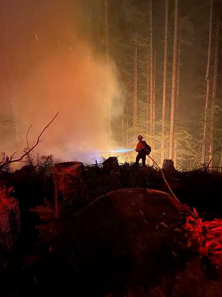 COURTESY PHOTO - Firefighting crews battle the Game Hog Creek Fire 22 miles northwest of Forest Grove. The fire had burned up to 190 acres as of July 19.