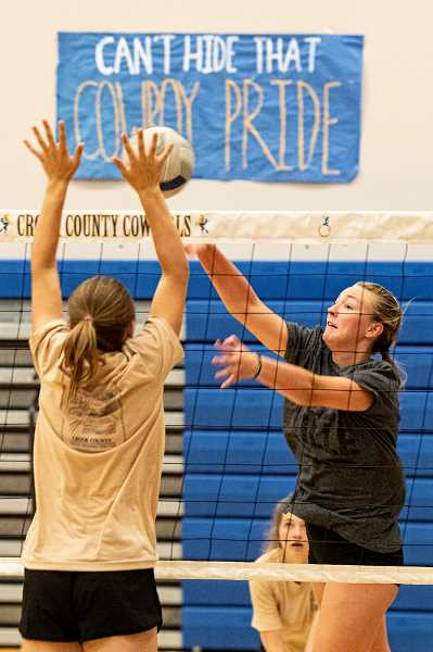 """LON AUSTIN - Haven Housely smacks a spike during the Cowgirls' volleyball camp at Crook County High School. The camp's focus is to help the program become more of a """"family"""" on and off the court."""