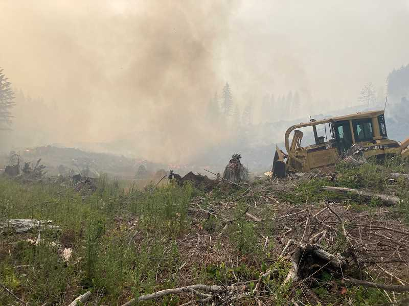 COURTESY PHOTO - Firefighting crews use a dozer to help fight the Game Hog Creek Fire burning 22 miles northwest of Forest Grove. More than 120 firefighting personnel are battling the wildfire.