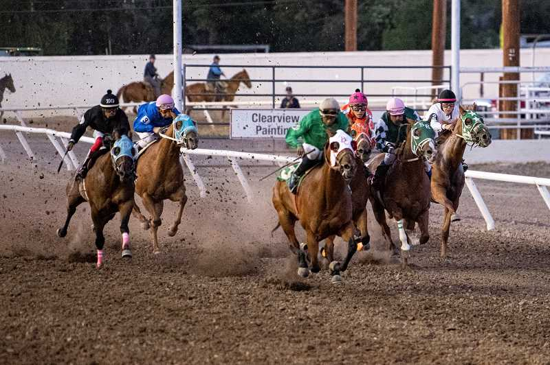 LON AUSTIN - Fooses Flyer, with James Wooten Jr. riding, took first in Friday night's race 4. Wooten, center in green silks, was named top jockey of the meet, winning nine of 29 races.