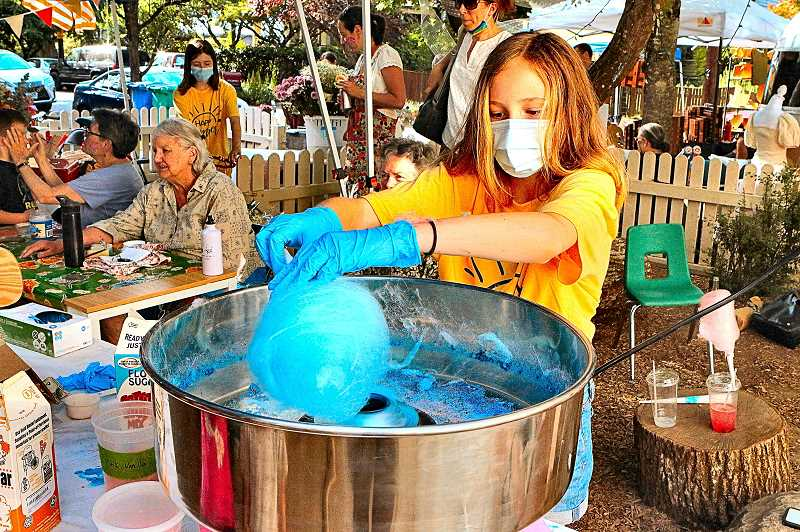 DAVID F. ASHTON - Here making cotton candy, its a Sellwood Community House Counselor in Training - as well as a Sellwood Middle School student - Maya Bamford!