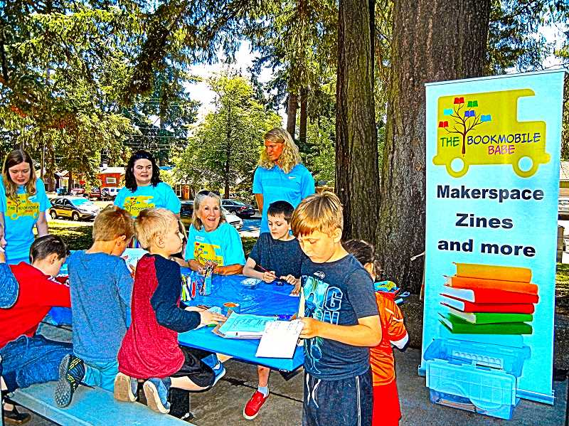 ELIZABETH USSHER GROFF - The Bookmobile Babe free summer literacy camp opened in early July at Lents Park with books and crafts. Adults helping the children paint rocks are, from left: Amanda Nelson, Anne Johnson, Judy Tester (seated) of Southeast Portland Rotary, and Steven Raymond.