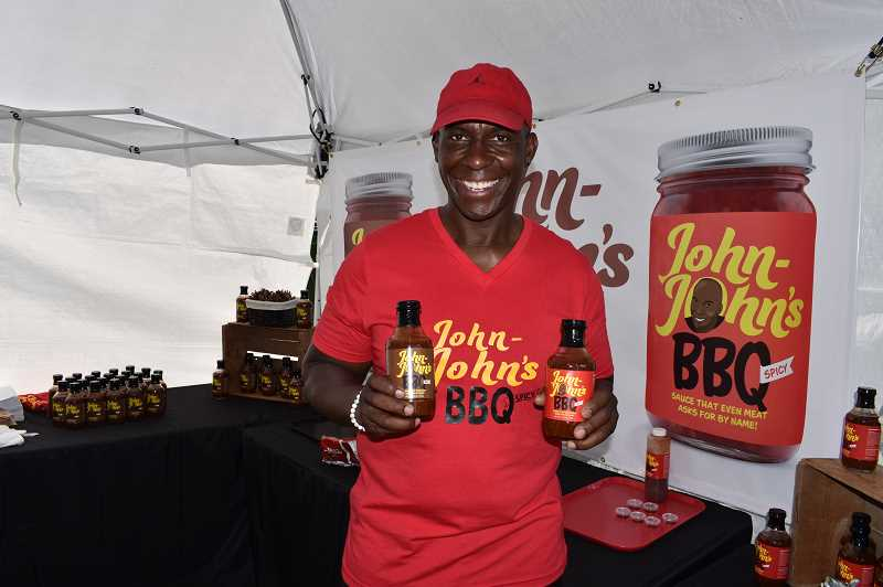 RAMONA MCCALLISTER - John Charles paused at his booth at Western Days at Ochoco Creek Park during Crooked River Roundup, where he displayed his two barbecue sauces — spicy and regular. The name of his company is John-John's BBQ.