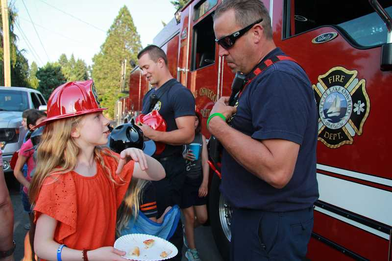PMG FILE PHOTO  - Chris Neely and Paul Corwin with the Lake Oswego Fire Department visit neighborhoods during National Night Out in 2019.
