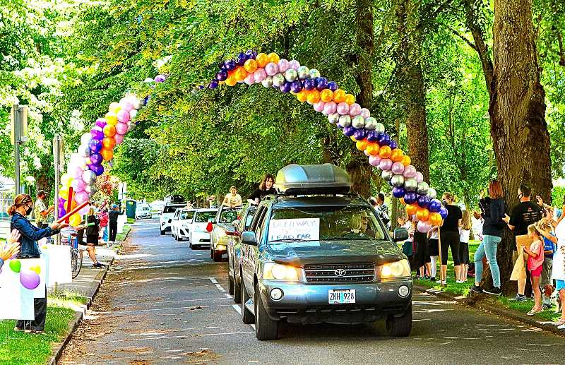 DAVID F. ASHTON - Vehicles, carrying graduating Duniway Elementary School fifth graders, paraded in front of the school on June 9th, along S.E. Reed College Place. It was called a graduation Honk-Out Parade.