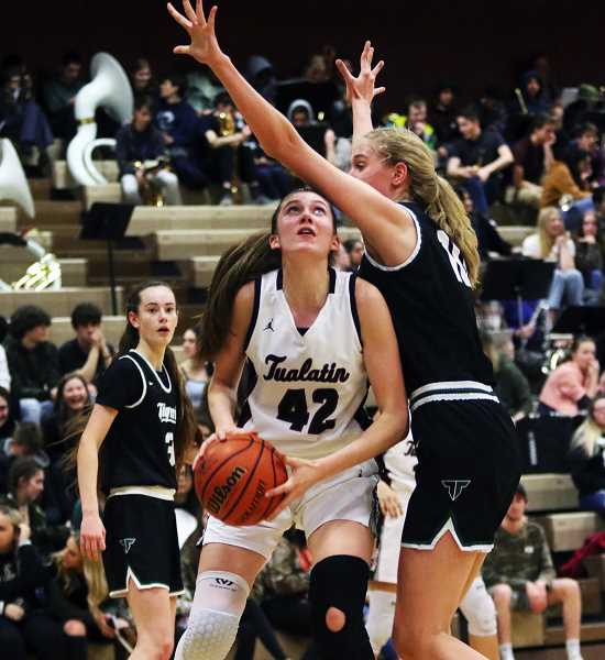 PMG PHOTO: DAN BROOD - Tualatin High School senior post Natalie Lathrop (42) was a first team All-Three Rivers League honoree for the Timberwolves in 2021.