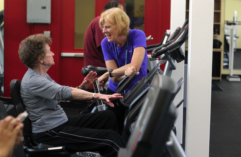 PMG FILE PHOTO - Personal trainer Carol Kirgger chats with Dolores Bowman in the Garden Home Recreation Center's fitness room in 2012, not long after the fitness room opened.