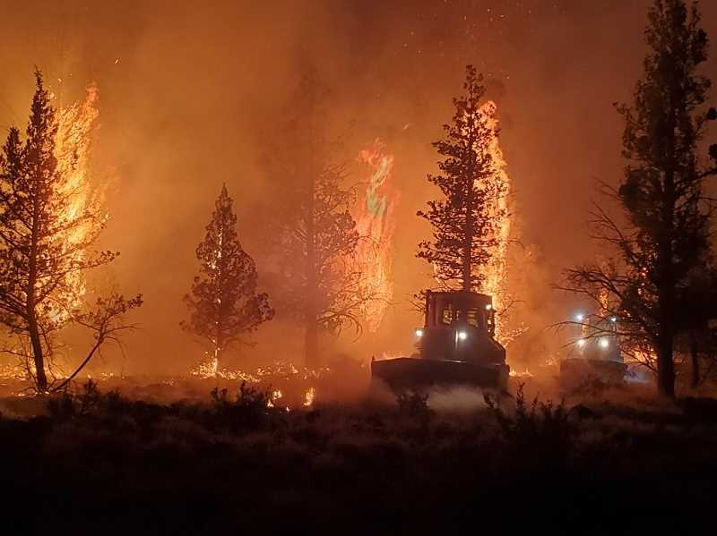 PHOTO COURTESY OF OCHOCO NATIONAL FOREST  - A bulldozer crew works the night operations on the Grandview Fire. As of Monday, July 19, the fire was 57% contained, burned approximately 6,032 acres, and over the duration of the fire had 619 personnel.