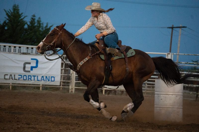 PMG PHOTO: ANNA DEL SAVIO - Tiffany Thompson competes in barrel racing at the Columbia County Rodeo on Saturday, July 17.