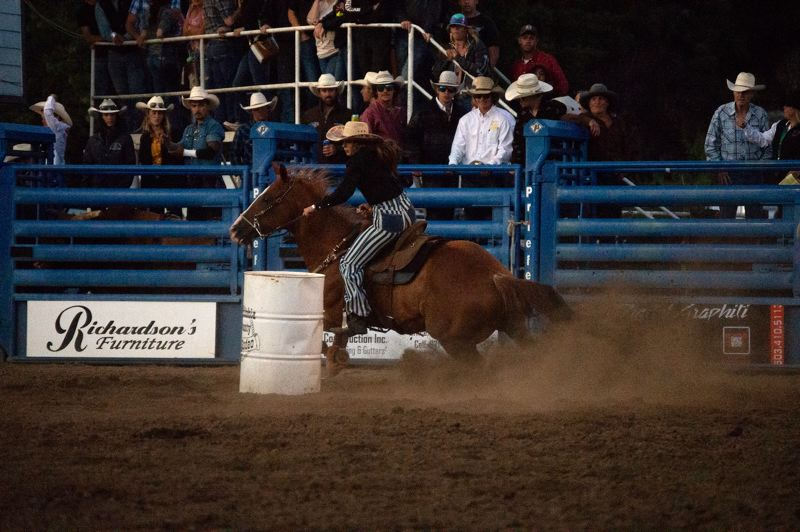 PMG PHOTO: ANNA DEL SAVIO - Kelsy Heller and her horse Opie race to the finish line after rounding the barrels.