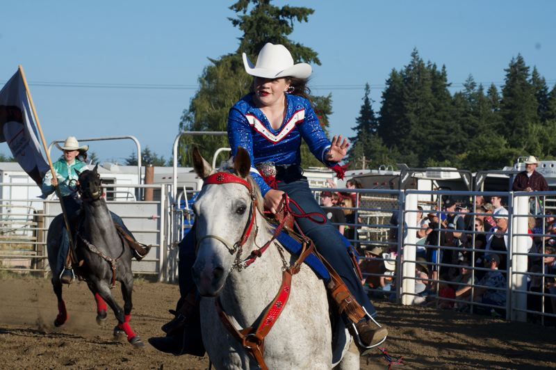 PMG PHOTO: ANNA DEL SAVIO - Columbia County Rodeo Court Princess Sophie Parrott rides with fellow rodeo court royalty at the rodeo in St. Helens.