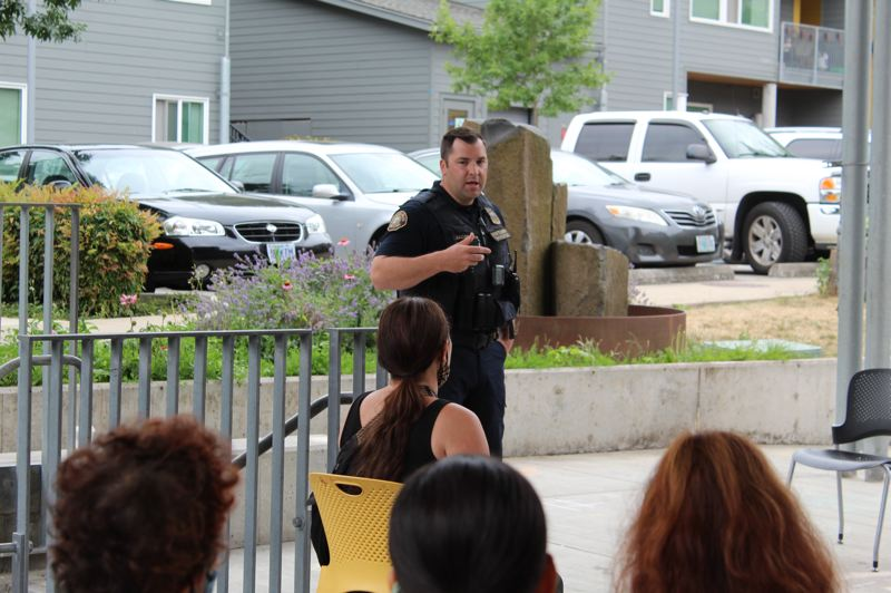PMG PHOTO: COURTNEY VAUGHN - Matt Jacobsen, an acting sergeant with the Portland Police Bureau, address residents at the Stephens Creek Crossing apartments in Southwest Portland following a shooting on June 29 that damaged several cars and buildings.