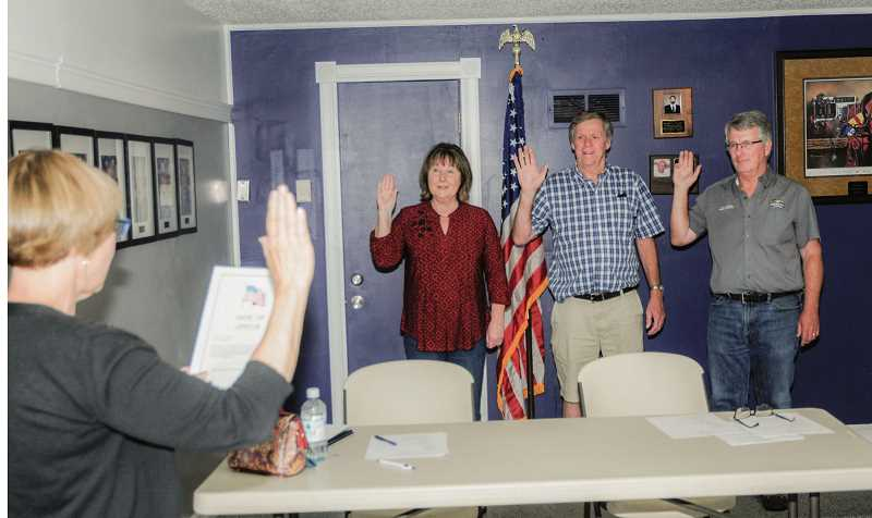 TOM BROWN FOR THE PIONEER  - Janet Brown, Mike Ahern and Joe Krenowicz swear in as board members for the Jefferson County Emergency Medical Services. Their goal is to work themselves out of their positions.