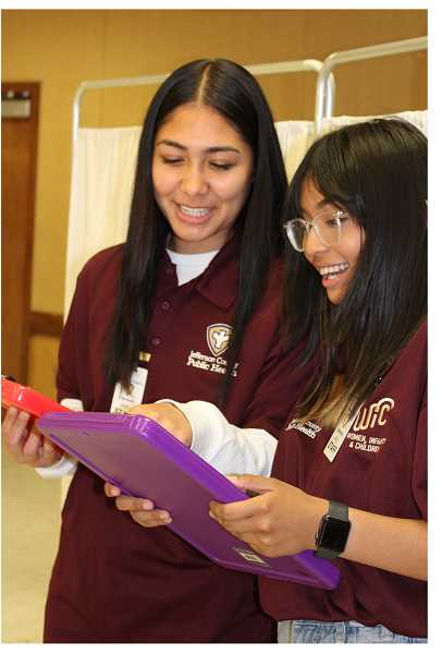 PAT KRUIS/MADRAS PIONEER   - Madras High School seniors Taya Holliday and Shantel Hernandez interned at Jefferson County Public Health this spring. The need for health workers during the pandemic boosted the learning experience beyond what they expected.