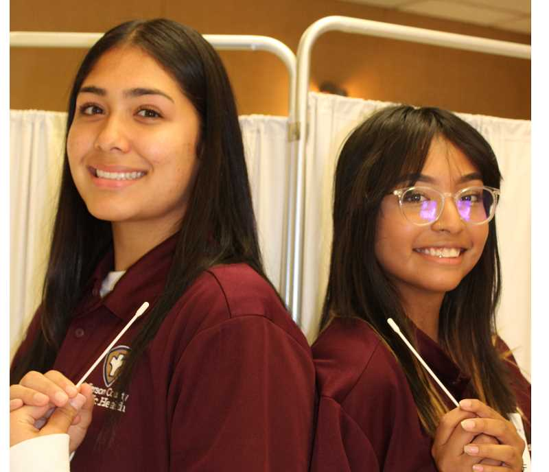 PAT KRUIS/MADRAS PIONEER   - Taya Holliday and Shantel Hernandez helped with COVID testing, vaccine clinics and contact tracing.