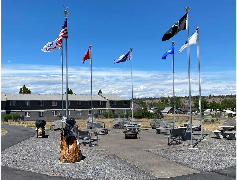 PHOTO COURTESY OF SHAWN STANFILL - The memorial includes a U.S. flag and flags of all branches of the military as well as benches and a fire pit.