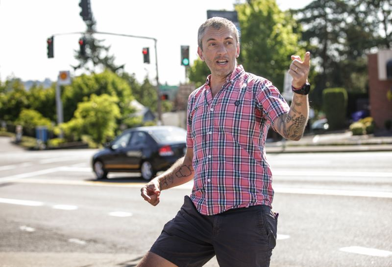 PMG PHOTO: JONATHAN HOUSE - Southwest Portland resident Caleb Spiegel talks about the problem of commuters cutting through his neighborhood near the intersection of Southwest Taylors Ferry Road and Terwilliger Boulevard during rush hour.