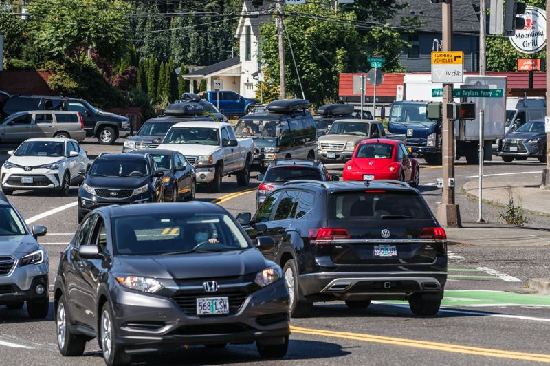 PMG PHOTO: JONATHAN HOUSE - Traffic backs up at the intersection of Southwest Terwilliger and Taylors Ferry Roads during rush hour.