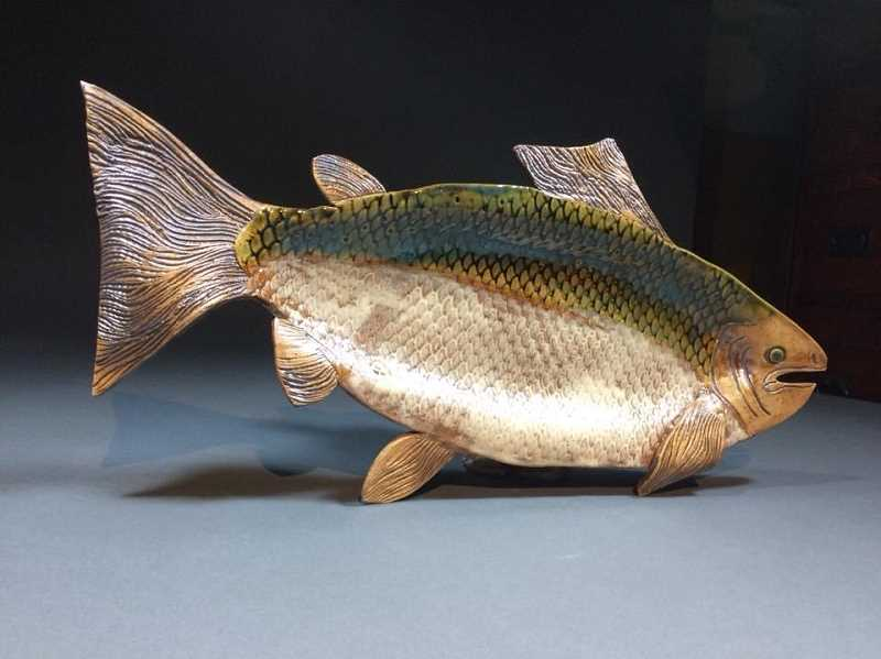 COURTESY PHOTO: TRIESTE ANDREWS - As this ceramic fish shows, Chris McClelland creatively partners with her husband, Bryan, to offer an eclectic display of pottery, everything from fanciful ceramic cottages to serving bowls and mugs.
