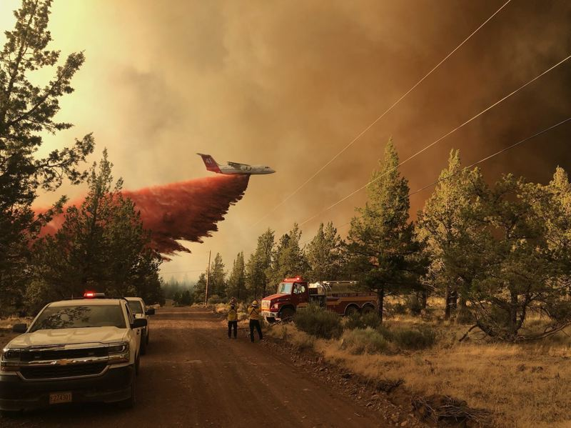 COURTESY PHOTO: INCIWEB.NWCG.GOV/ - An air tanker drops flame retardant on the Grandview Fire in Jefferson County.