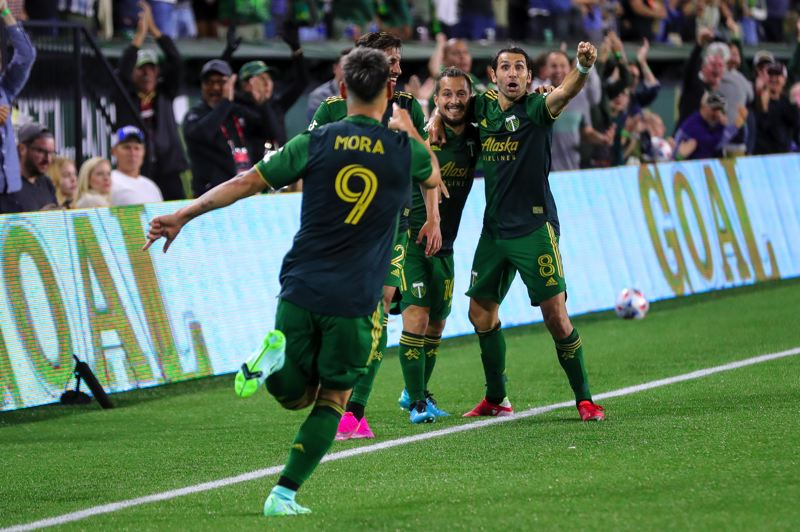 PMG PHOTO: JONATHAN VILLAGOMEZ - Diego Valeri and teammates celebrate after Felipe Mora scored the game-winning goal Wednesday as the Timbers beat LAFC, 2-1.