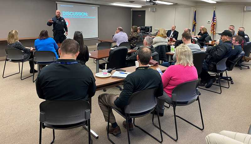COURTESY PHOTO: ST. HELENS SCHOOL DISTRICT - PoliceSgt. Evin Eustice speaks to St. Helens School District's first responders group.