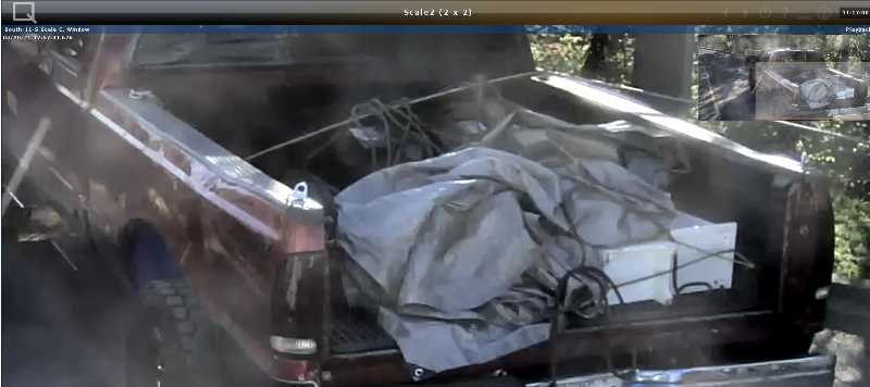 PHOTO COURTESY: METRO - A screengrab from Metro surveillance footage in April appears to show a rope in the bed of a red truck.