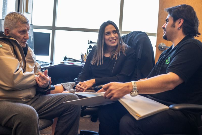 PMG PHOTO: JONATHAN HOUSE - Business advisor Emma Clark, center, and mentor Dean Buse, left, helped client Stephen Parisio on his business plan through IMPACT Beaverton in 2020.