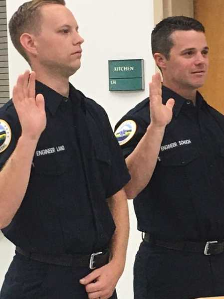 COURTESY PHOTO: WOODBURN FIRE DISTRICT - Firefighters James Lang, left, and Jerrod Schuch were sworn into duty with the Woodburn Fire District on July 21, 2021.
