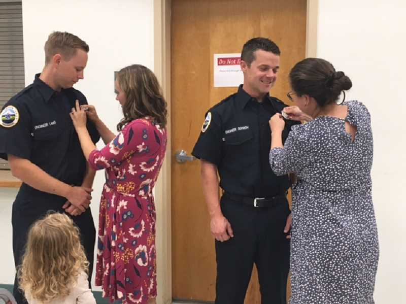 COURTESY PHOTO: WOODBURN FIRE DISTRICT - Firefighters James Lang, left, and Jerrod Schuch received their badgest after being sworn into the Woodburn Fire District on July 21, 2021.