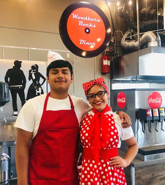 COURTESY PHOTO: ERIC SWENSON - Isaak Flores and Yesenia Lopez hired on to help the Swenson family with their new 1950s-style diner, 'Woodburn Rocks.' Located downtown in the Metropolis building, the diner and Tequilas Bistro Bar will hold grand openings beginning at 5 p.m. Friday, July 30.