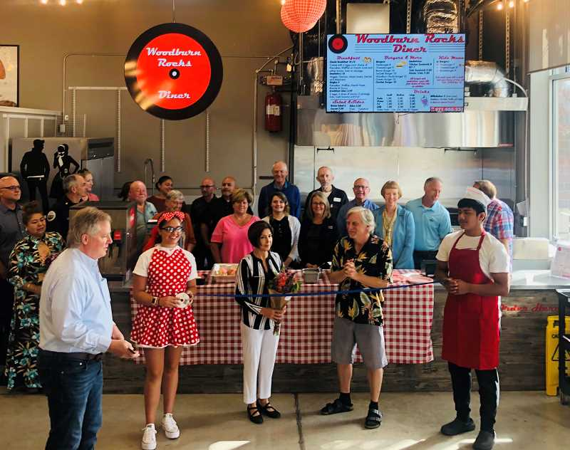COURTESY PHOTO - Woodburn Area Chamber of Commerce holds a ribbon cutting for Woodburn Rocks Diner at the Metropolis. The diner and another Metropolis recent addition, Tequilas Bistro Bar, will hold grand openings beginning at 5 p.m. Friday, July 30.