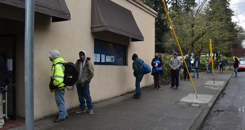 PMG PHOTO: RAYMOND RENDLEMAN - Homeless people line up recently for services outside of the Father's Heart Street Ministry in Oregon City.