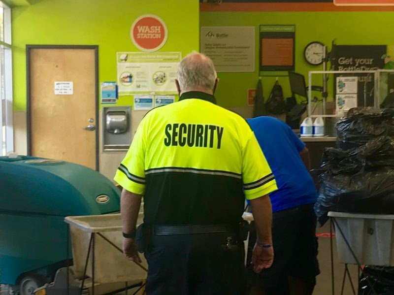PMG PHOTO: ZANE SPARLING - A security guard patrols inside the Delta Park BottleDrop facility in North Portland on Friday, July 23.