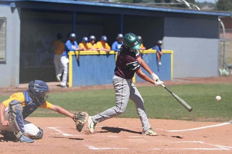 PMG PHOTO: TANNER RUSS - North Marions Hunter Hansen connects in the Berries 5-4 win over Newberg on July 24.