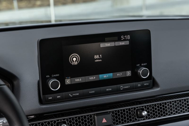 COURTESY AMERICAN HONDA MOTOR CO. - The dispaly screen in the 2022 Honda Civic has been moved higher up on the dash, where it is easier to read while driving. The honeycomb metal strip below it houses the air conditioning ducts.