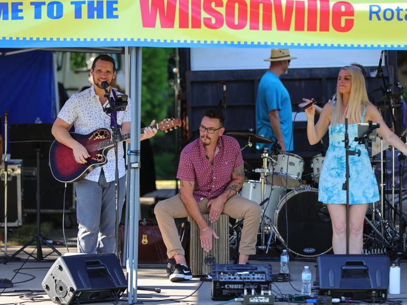 PMG PHOTO: JONATHAN VILLAGOMEZ - Christine Yvette, Bryan Podwys and Eric Storm kicked off the Rotary Club of Wilsonville's Summer Concert Series.