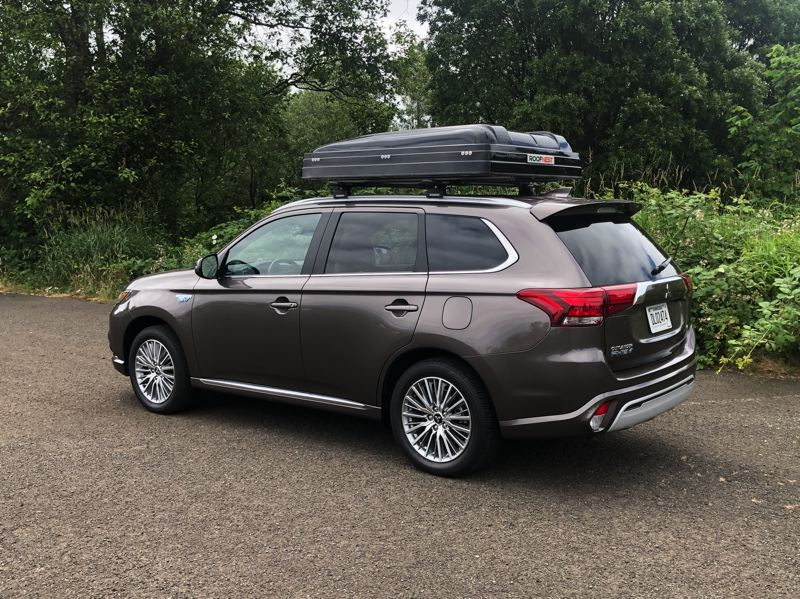 PMG PHOTO: JEFF ZURSCHMEIDE - The 2021 Mitsubishi Outlander PHEV will go about 24 miles on a full chanrge of electricity alone befoe switching over to a convention fuel saving hybrid mode.