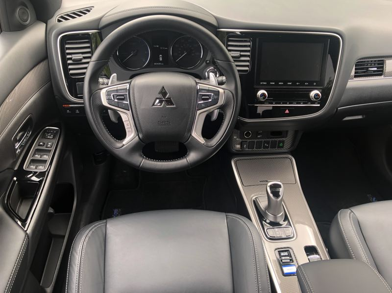PMG PHOTO: JEFF ZURSCHMEIDE - The interior of the 2021 Mitsubishi Outlander PHEV is clean and functional, with a large display screen and advanced automotive technologies.