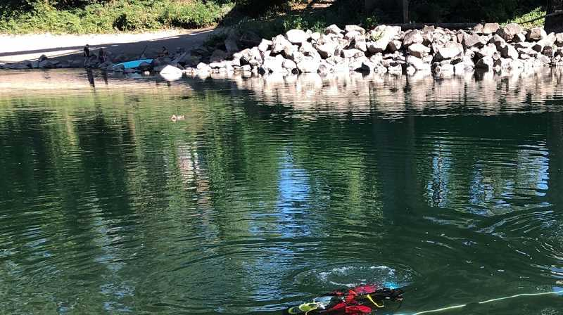 COURTESY PHOTO: CCSO - Clackamas County diving crews lead a recovery effort after body was discovered in the Clackamas River on Friday, July 23.