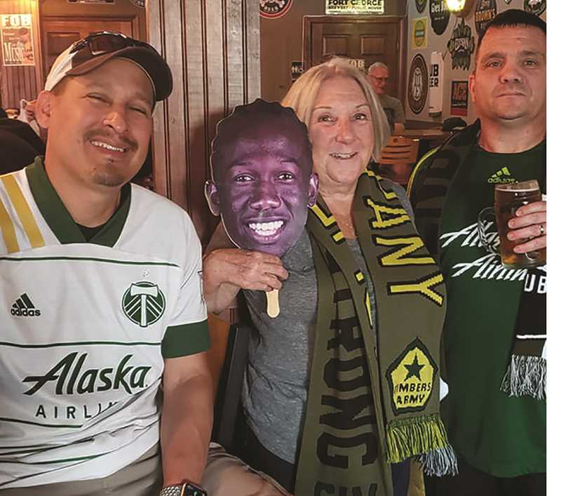 COURTESY PHOTO: KATHERINE LEPPEK - A new Portland Timbers supporters group has formed in Canby and their headquarters is the FOB Taproom on game days thanks to the work of Katherine and Bruce Leppek.