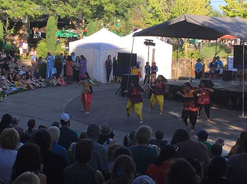 PMG PHOTO: PETER WONG - Deepa Barve and Bollywood Troupe perform June 20, 2019, at The Round during the Beaverton Night Market. The event is returning in-person in August.