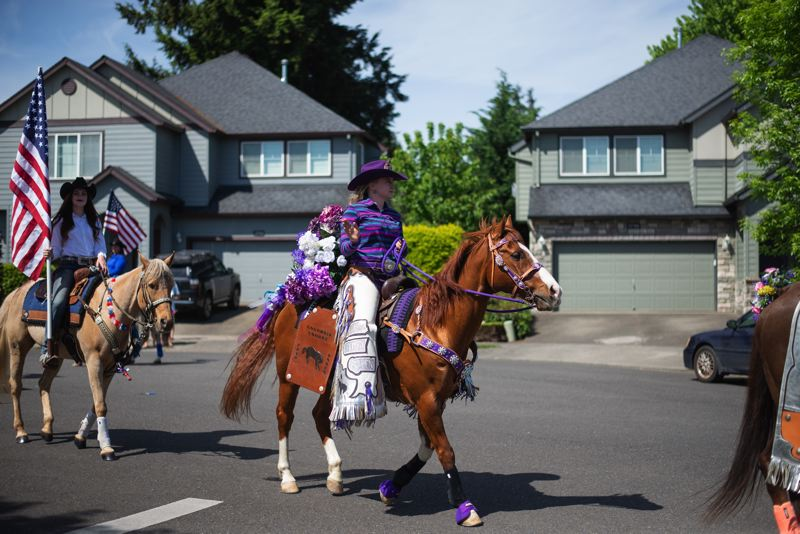 PMG PHOTO: ANNA DEL SAVIO - 2020 Columbia County Fair and Rodeo Queen Jessica Lincoln participates in a parade on May 9, 2020, through Scappoose.
