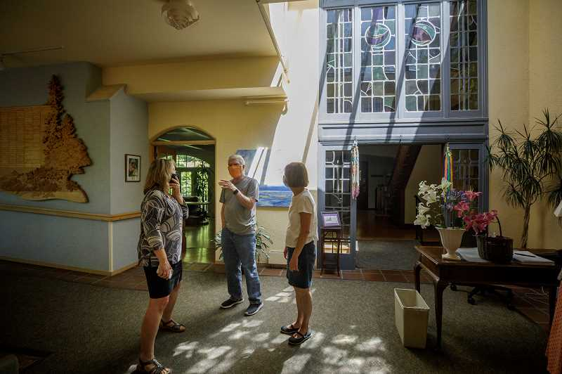 PMG PHOTO: JONATHAN HOUSE - Kathy Hostetler (left) leads a tour of Hopewell House. To the right, Robert and Paula Hamilton observe the historic home that is slated to be reopened as a hospice care facility next year.