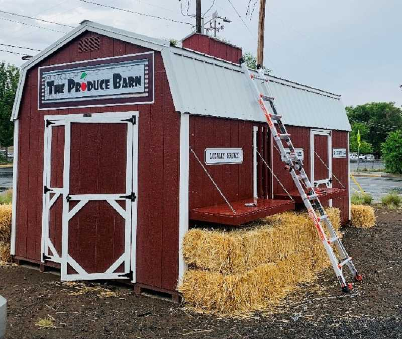 PHOTO COURTESY OF CHERI BOWEN - Green Drive Mercantile owners Devon and Cheri Bowen will soon open The Madras Produce Barn at the corner of Southwest Third and Southwest D streets. The Madras Produce Barn will sell locally sourced produce, meat and products.