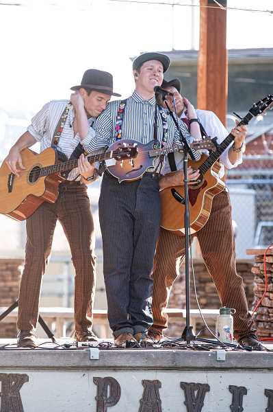 """LON AUSTIN/CENTRAL OREGONIAN - The high energy trio hit the stage with a """"do rock n' roll with a hillbilly soul"""" style of performance."""