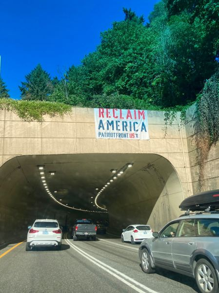 SUBMITTED PHOTO - A banner from the group Patriot Front urged Portland area commuters at the Vista Ridge tunnels on eastbound U.S. Route 26 to 'reclaim America' on Friday, July 23.